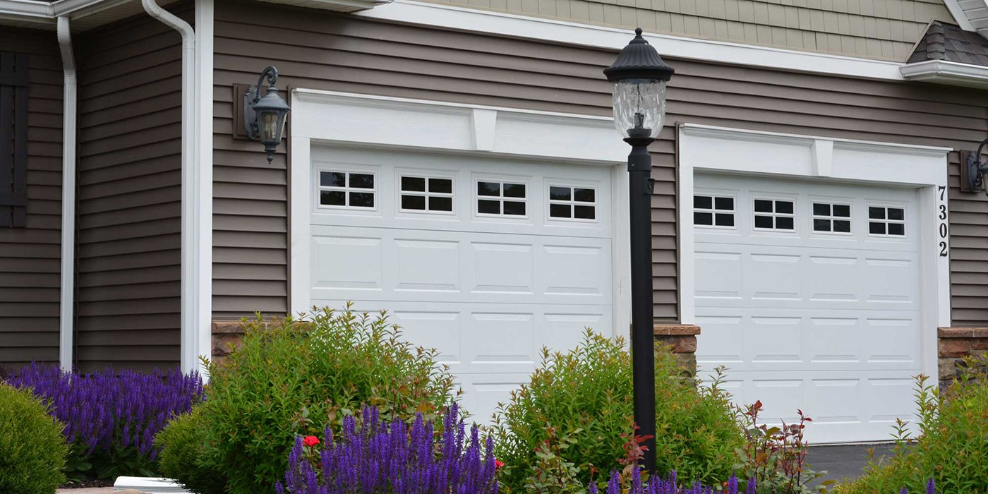 a residential garage with two garage doors