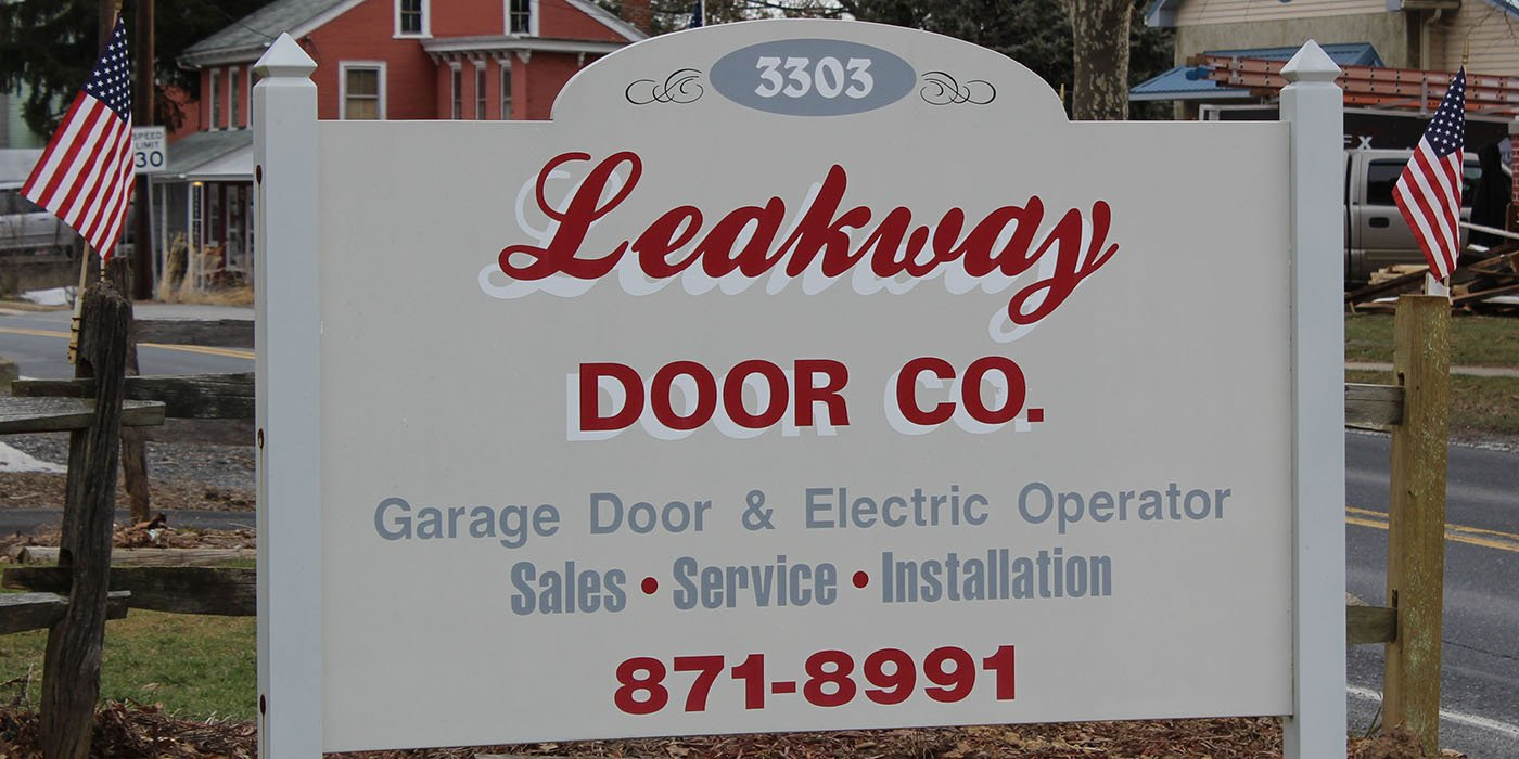 Leakway Door Co road sign for garage door & electric operator sales, service and installation