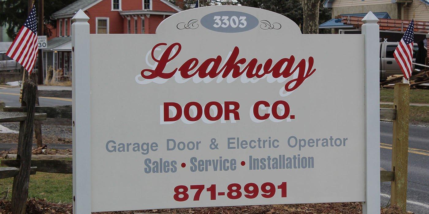 Leakway Door Co road sign for garage door & electric operator sales, service and installation