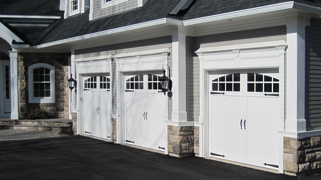 garage with 3 Leakway Custom Garage Doors
